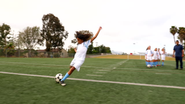 ts young female soccer player taking shot while warming up before game - pacific islander girl stock videos & royalty-free footage