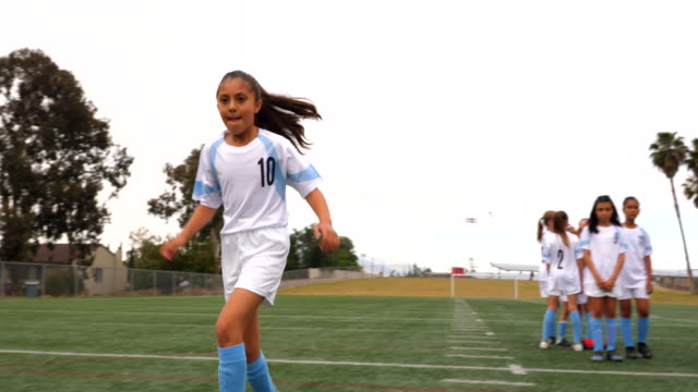 ts young female soccer player taking shot while warming up before game - football team stock videos & royalty-free footage