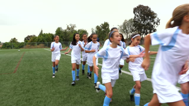 ts young female soccer players high fiving parents on sidelines after soccer game - girls stock videos & royalty-free footage