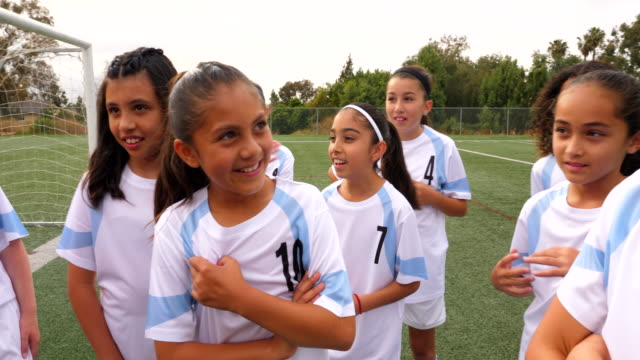 ms young female soccer players laughing together on field before practice - pacific islander girl stock videos & royalty-free footage
