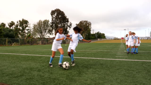 ts young female soccer players running defensive drills on field before game - pacific islander child stock videos & royalty-free footage