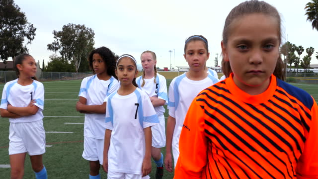 ms young female soccer team walking across field - warm up exercise stock videos & royalty-free footage
