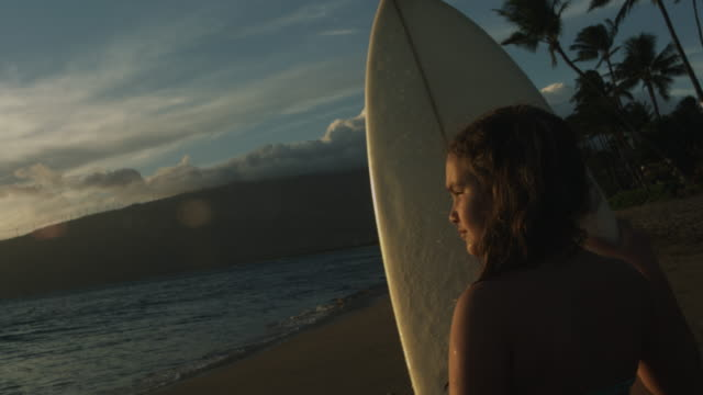 a young female surfer looks for waves in maui, hawaii. - pacific islander girl stock videos & royalty-free footage