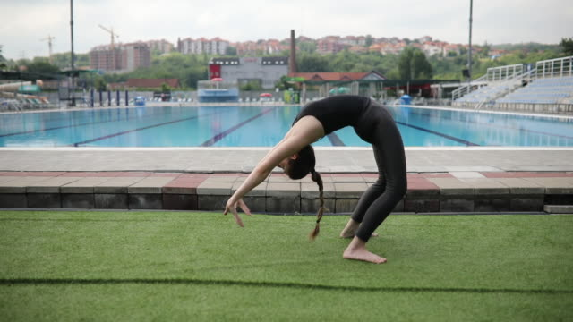 young female swimmer - cartilagine video stock e b–roll