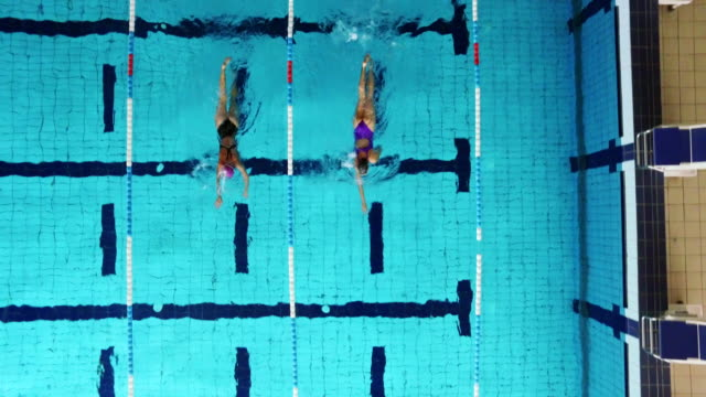 young female swimmers in the pool - swimming cap stock videos & royalty-free footage