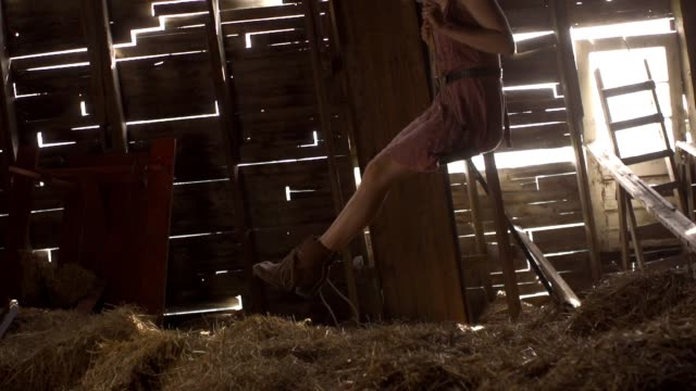 young female swinging in a barn - tyre swing stock videos & royalty-free footage