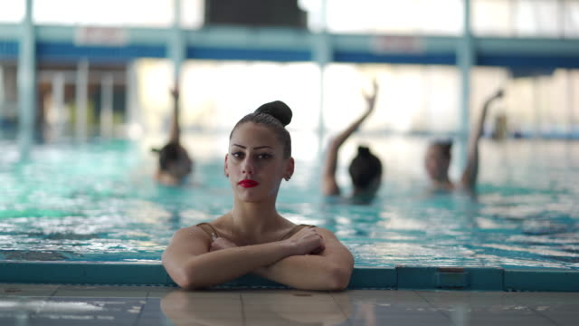 young female synchronized swimmer - woman swimming costume stock videos & royalty-free footage