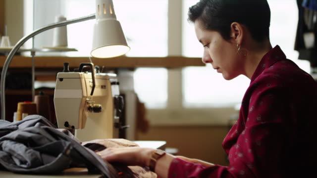 ms young female tailor at work / provo,utah,usa - provo bildbanksvideor och videomaterial från bakom kulisserna