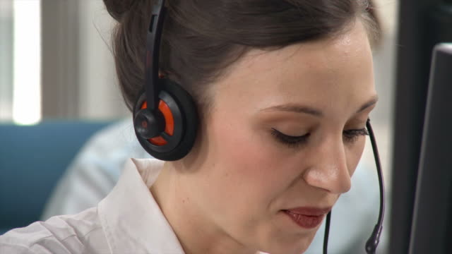 hd: young female telephone worker - switchboard operator stock videos & royalty-free footage