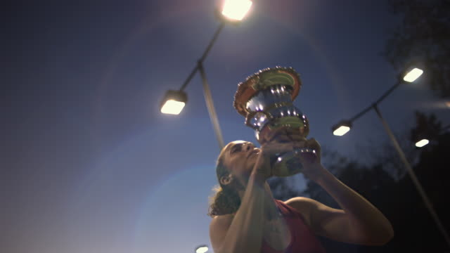 CU, LA, Young female tennis player holding trophy, dusk, Santa Barbara, California, USA