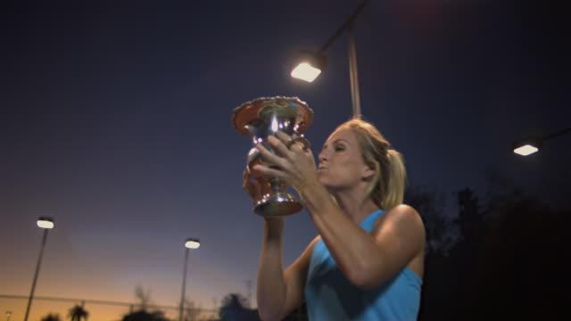 CU, LA, Young female tennis player holding trophy, dusk, Santa Barbara, California, USA