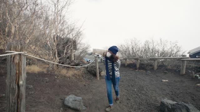 young female tourist admiring mt.fuji's mossy landscape - satoyama scenery stock videos & royalty-free footage
