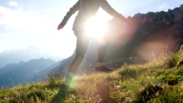 young female tourist walking up a mountain - stepping stock videos & royalty-free footage