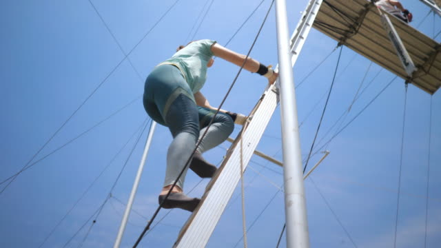 young female trapeze artist climb up the ladder before flying - ladder stock videos & royalty-free footage
