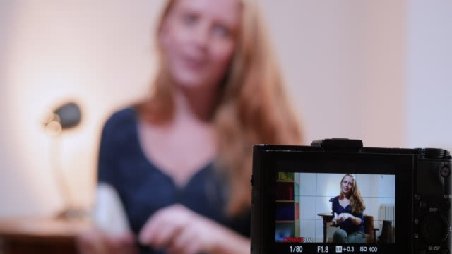 stockvideo's en b-roll-footage met young female vlogger, speaking about cancer - generation z