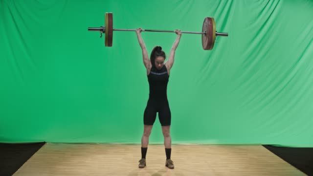 ld young female weightlifter lifting the barbell performing the clean and jerk lift - weight training stock videos & royalty-free footage