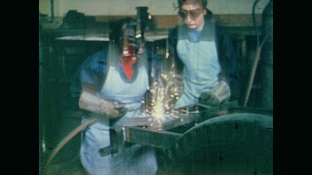 young female welders assemble sheet metal to fabricate emergency buggy - sheet metal点の映像素材/bロール