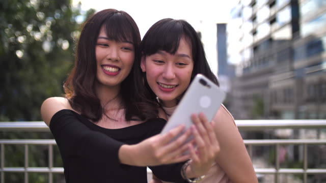 young female woman taking a selfie in bangkok thailand - female friendship stock videos & royalty-free footage