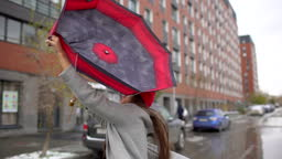 Young female woman with umbrella standing outdoors
