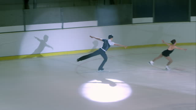 ts young figure skating pair performing - ice skating stock videos and b-roll footage