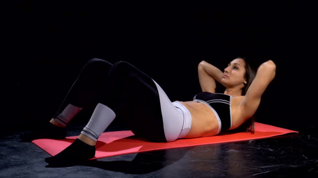 young fit woman doing crunches - human limb stock videos & royalty-free footage