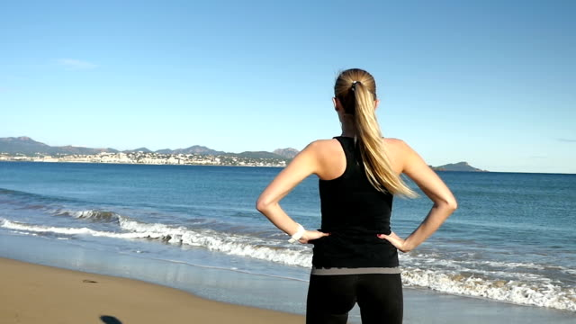 young fitness girl looking at sea view - hand on hip stock videos & royalty-free footage