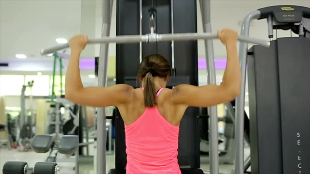 young fitness woman execute exercise with exercise-machine in gym, - cardiovascular exercise stock videos & royalty-free footage
