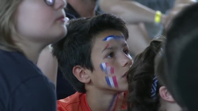 stockvideo's en b-roll-footage met young football fans in paris anxiously watch as france squeeze past australia 2-1 in a match that saw the first var assisted penalty awarded in the... - var