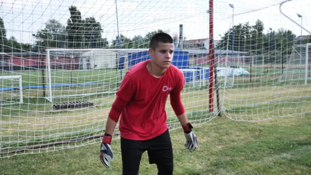 young football goalkeeper and penalty shots - goalkeeper stock videos & royalty-free footage