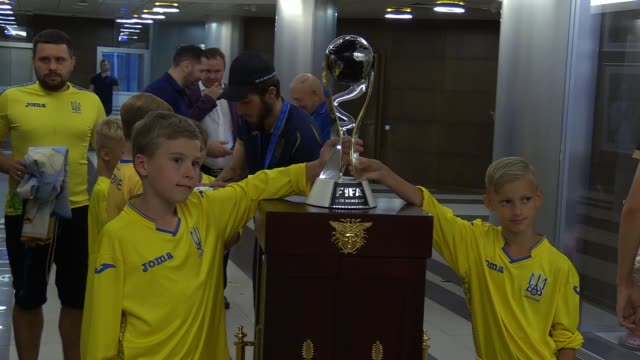 young football players pose for a photo with the fifa u20 world cup trophy during a meeting ceremony of ukrainian u20 national soccer team players,... - fifa stock videos & royalty-free footage