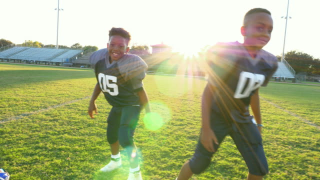 MS Young football teammates playing on field after football practice