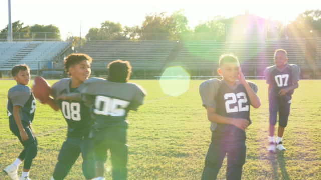MS Young football teammates playing on field before football practice
