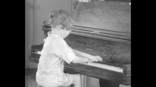 young frances laska playing grand piano / closer shot of her hands playing / close shot of her foot pushing pedal under piano pedal is placed atop a... - piano stock videos & royalty-free footage