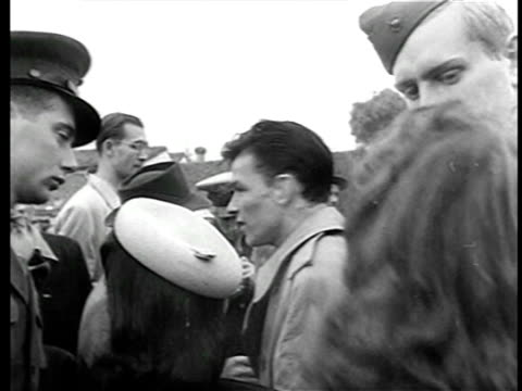 b/w 1944 young frank sinatra surrounded by crowd at golf competition raising funds for war bonds - uniform stock videos & royalty-free footage