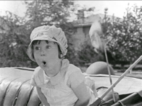 B/W 1927 young freckled girl (Baby Peggy) in backseat of convertible looking surprised / feature