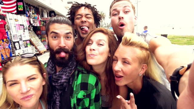 SLOW MOTION - Young Friends Fun Selfie at Venice Beach, Los Angeles.
