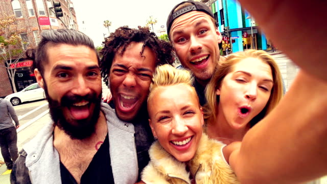SLOW MOTION - Young Friends Fun Selfie on Santa Monica Street, Los Angeles.