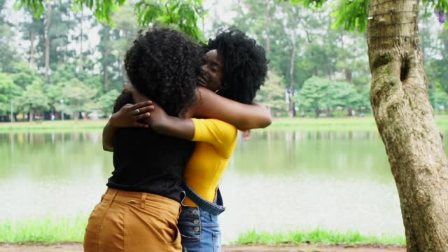 young friends girls embracing in the park - reconciliation stock videos & royalty-free footage