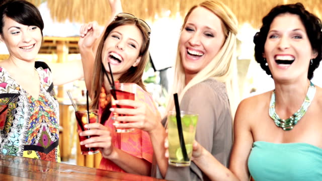 Young friends having cocktail