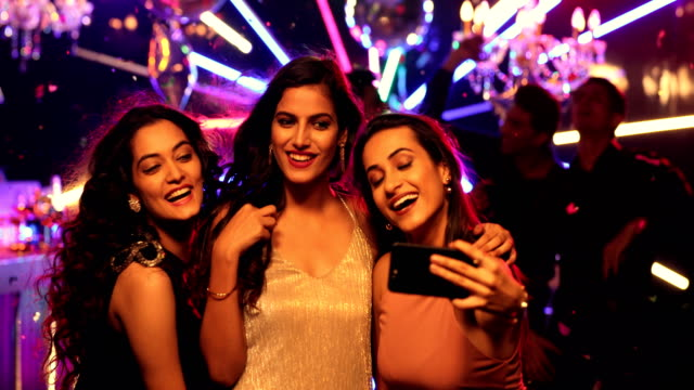 MS Young friends posing for selfie in party at nightclub / India