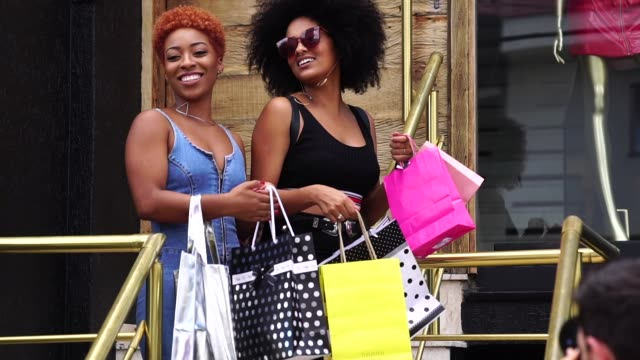 young friends shopping in the street - glamour stock videos and b-roll footage