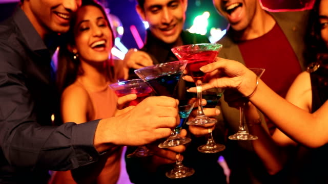 ms young friends toasting cocktail glasses at nightclub / india - celebratory toast stock videos & royalty-free footage