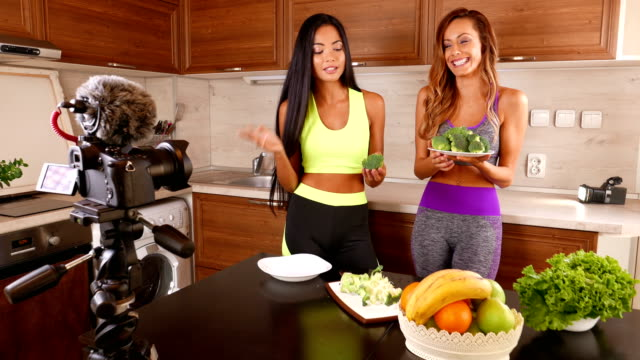 young friends vlogger recording a healthy eating video for theirs vlog - 4k video - blogging stock videos and b-roll footage