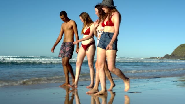 young friends walking at the coastline - queensland stock videos & royalty-free footage