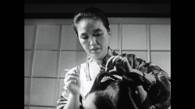 ms young geisha having hair styled by mother; 1964 - produced segment stock videos & royalty-free footage