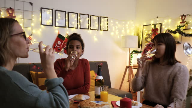 young generation z friends at home at christmas dinner, raising the toast - evening meal stock videos & royalty-free footage