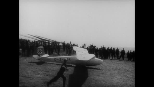 young german boys enjoy the paper gliders of youth but soon grow into hitler's recruits for the newly formed luftwaffe - glider stock videos & royalty-free footage