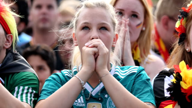 A young German female fan in a football shirt is praying while Germany is loosing the 2018 FIFA World Cup Russia Group F match against Korea Republic...