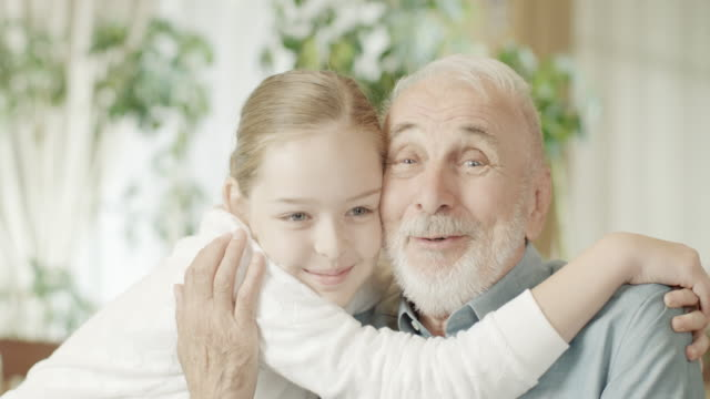 young girl and grandfather - grandfather stock videos & royalty-free footage