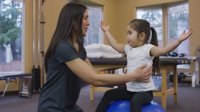 young girl at physical therapy session - injured stock videos & royalty-free footage